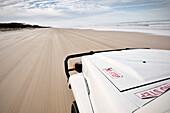 Self drive tour on Fraser Island along beach, offroad vehicle, UNESCO world heritage site, Queensland, Australia