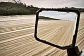 Offroad vehicle in mirror while driving at sand island, Fraser Island, UNESCO world heritage, Queensland, Australia
