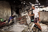 Boiling anchovies for production of fish sauce, fishing village, Mui Ne, Binh Thuan, Vietnam