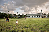 Locals play rugby in front of a church, typical village lifestyle, Apia, Upolu, Samoa, Southern Pacific island