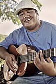Young Samoan plays the guitar in a park, Apia, Upolu, Southern Pacific island