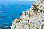 Mountaineers at Staffelstein, Kampenwand, lake Chiemsee in background, Chiemgau, Upper Bavaria, Germany