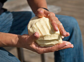Man froming butter, Hofbauern-Alm, Kampenwand, Chiemgau, Upper Bavaria, Germany