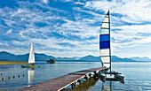 Catamaran beside jetty at lake Chiemsee, Schuetzing, Chieming, Chiemgau, Upper Bavaria, Germany