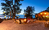Guests in a beachbar in the evening, lido, Uebersee, lake Chiemsee, Chiemgau, Upper Bavaria, Germany