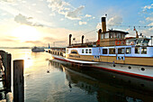Excursion boat in harbor in the morning, Prien, lake Chiemsee, Chiemgau, Upper Bavaria, Germany