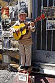 Gardelito, Tango street musician with guitar, San Telmo, near Plaza Dorrego, Buenos Aires, Argentina