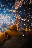 Correfoc  Catalan traditional festival 16th August where people dressed as devils light fireworks while dancing in the street, La Bisbal d Emporda, Baix Emporda, Costa Brava, Girona province, Catalonia, Spain