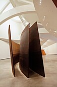 Spain, Basque Province Euskadi, Bilbao, Guggenheim Museum by river Nervion, architect Franck Gehry, huge corten iron sculptures by american artist Richard Serra