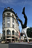 Germany, Wuppertal, Wupper, Bergisches Land, North Rhine-Westphalia, NRW, D-Wuppertal-Elberfeld, Sasse House, business premises, sidewalk cafe, sculpture ´A new successful day´ by Guillaume Bijl, businessman does a handstand