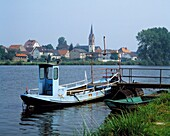 Germany. Grosskrotzenburg, Main, Rhine Main Area, Hesse, city view, river landscape, Main landscape, city view, catholic church, old Main ferry and rowing boat