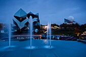 France, Poitou-Charentes Region, Vienne Department, Poitiers, Futuroscope Science Park, IMAX theater and fountains, evening