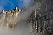 Clouds and sheer granite clif walls above Yosemite Valley, Yosemite National Park, California