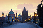 architecture, art, bridge, Charles bridge, cities, city, cityscape, colour, Czech Republic, dawn, Europe, exterior, lamp, lantern, light, morning, outdoor, outdoors, outside, Prague, praha, stare mesto, statue, tower, spire, urban landscape, world travel.