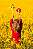 agricultural, agriculture, beautiful, blond, boy, canola, child, colourful, country, cute, field, flower, hair, kid, nature, plant, play, pinwheel, rape, red, rural, spring, springtime, summer, yellow. agricultural, agriculture, beautiful, blond, boy, can