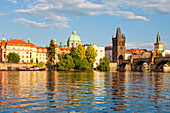 architecture, bridge, Charles bridge, cities, city, cityscape, colour, Czech Republic, day, Europe, exterior, outdoor, outdoors, outside, Prague, praha, river, stare mesto, statue, tower, spire, urban landscape, world travel. architecture, bridge, Charles