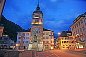 Travel, Geography, Architecture, Culture, History, Europe, Switzerland, Uri, Altdorf, Town, Center, Wilhelm Tell, Statue, Sightseeing, Illuminated, Dusk, Night, Horizontal. Travel, Geography, Architecture, Culture, History, Europe, Switzerland, Uri, Altdo
