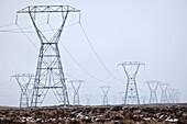 Power pylons on Rangipo desert during rain storm, Tongariro National Park.