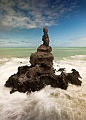 Sea stack off Tumbledown Bay, southern bays of Banks Peninsula, Canterbury, New Zealand.