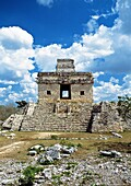 Temple of the Dolls Templo de las Siete Muñecas is an imposing looking building on a pyramidal base with a short tower atop its roof  A monolithic stela stands at its front like a sentinel guarding its entrance  The doorways of the temple were built in ex