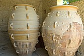Pithoi storage jars supposedly used for storing wine, cereals, olive oil  Knossos, the Minoan Palace lies 5 kilometres southeast of Heraklion, in the valley of the river Kairatos  Crete Island  Greece