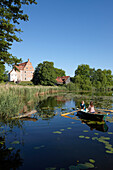 Two women in a rowing boat on lake Ulrichshusen, Ulrichshusen castle, Mecklenburg-West Pomerania, Germany