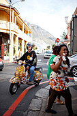Man on leopard print scooter cruising through Observatory, Southern Suburbs, Cape Town, South Africa, Africa