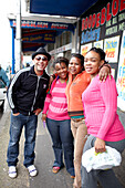Comedian Kurt Schoonrad striking a pose with three women, Cape Town, South Africa, Africa