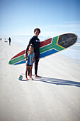 Surfer Alfonso Peters on the beach, Muizenberg, Peninsula, Cape Town, South Africa, Africa