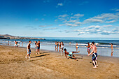 Playing football on the beach, Playa del Ingles, Gran Canaria, Canary Islands, Spain