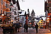 Horse Carriage, Shopping street in the evening, Old Town, Parish Church and Liebfrauen Church, Vorderstadt, Kitzbuhel, Tyrol, Austria
