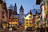 Shopping street in the evening, Old Town, Parish Church and Liebfrauen Church, Vorderstadt, Kitzbuhel, Tyrol, Austria