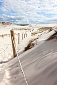 Fence in the dunes of Leba, UNESCO World Biosphere Reserve, Slowinski National Park, Polish Baltic Sea coast, Leba, Pomeranian, Poland
