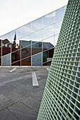 Modern architecture with reflection of the Aachen Cathedral, UNESCO World Heritage Site, Aachen, North Rhine Westphalia, Germany