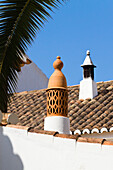 Chimneys on cottage, icon of the Algarve, Portugal, Europe