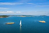Fjord with sailing boat close to Marstrand, Bohuslan, Vastra Gotalands lan, Sweden, Europe