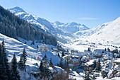 View on Andermatt with Maria Hilf church, winter, Urseren, Canton Uri, Switzerland