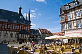 Street cafe, guild hall, Marktplatz, Wernigerode, Harz, Saxony-Anhalt, Germany