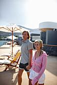Couple on the terrace of Yachting Club, Beach Resort, Elounda, Crete, Greece