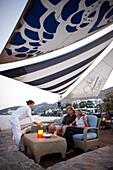 Couple at a beach bar in the evening, Elounda, Agios Nikolaos, Crete, Greece