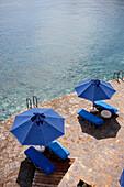 Sunshades and deck chairs at the seasite, Elounda, Agios Nikolaos, Crete, Greece
