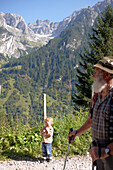 Child and mountain guide on a hiking path in the mountains, Gossensass, Brenner, South Tyrol, Trentino-Alto Adige/Suedtirol, Italy