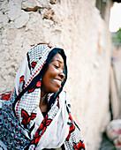 Woman wearing Kanga, in Jambiani village, southeast, Zanzibar, Tanzania, East Africa
