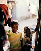 Girl in courtyard, family house, traditional coral stone house, Jambiani village, Zanzibar, Tanzania, East Africa