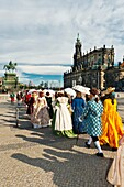 A procession of the Royal Court of August the Strong people in historical costume in Theaterplatz, Dresden, Saxony, Germany