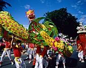 Asia, Asian, celebration, costumes, dragon, festive. Asia, Asian, Celebration, Costumes, Dragon, Festive, Holiday, Landmark, Men, Outdoors, Parade, People, Singapore, Asia, Symbolic