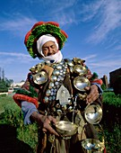 Africa, African, brass, carafe, costume, cups, head. Africa, African, Brass, Carafe, Costume, Cups, Headdress, Holiday, Landmark, Man, Moroccan, Morocco, Africa, Outdoors, People, R