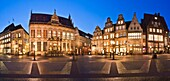 Panoramic view of illuminated houses and the House Schuetting in Bremen in the evening, Germany, Europe