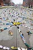 Detroit, Michigan - An art exhibit of thousands of shoes on the street represents the issue of homelessness  The exhibit by artist Tyree Guyton is called ´Street Folk ´ It is part of of Art X Detroit, a collection of performance art, music, and literary e