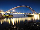 The Humber River Arch Bridge in Toronto at night also known as the Humber Bay Arch Bridge or the Gateway Bridge  Toronto, Ontario, Canada